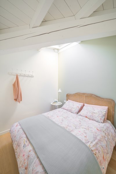 The large master bedroom on the first level has a large bathroom with a shower and bathtub.