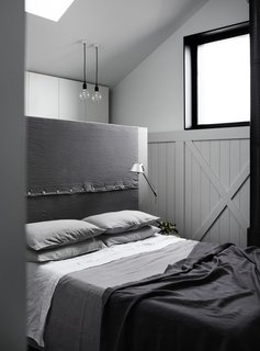 The innovative conceptual framework draws in plenty of natural light, and results in a seamless connection between different parts of the house. The wardrobe in the bedroom is hidden behind the bedhead box.