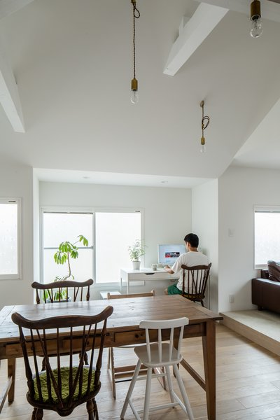 Dark, traditional, Japanese-style furniture were swapped for light, modern Lauan plywood built-in cabinetry that helped open up the living and dining areas.