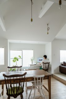 Whether you're short on space or funds, a home office is still possible. Here, a corner of a spacious eat-in kitchen serves as the perfect space for a desk, chair, and minimal storage. Re-thinking your home's layout and making the most of unused spaces is one of the best ways to incorporate home office ideas on a budget.