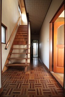 The entrance foyer and stairs before the renovation.