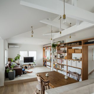 Additional windows and open shelving help Suita House in Osaka feel airy and modern.