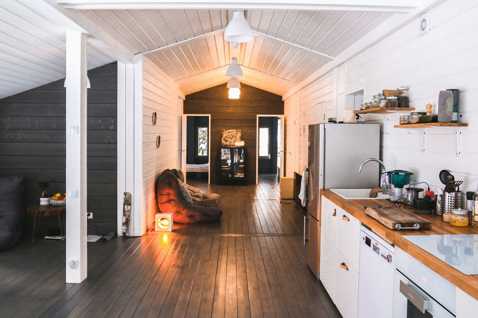 Kitchen, Wood Counter, Dishwasher, Drop In Sink, White Cabinet, Refrigerator, Ceiling Lighting, and Dark Hardwood Floor This model starts at $94,747, but you can pay for add-ons like a sauna and side terrace.  Photo 19 of 22 in DublDom Prefab Homes Can Be Built in One Day