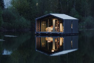 A DublDom house rests on a barge.