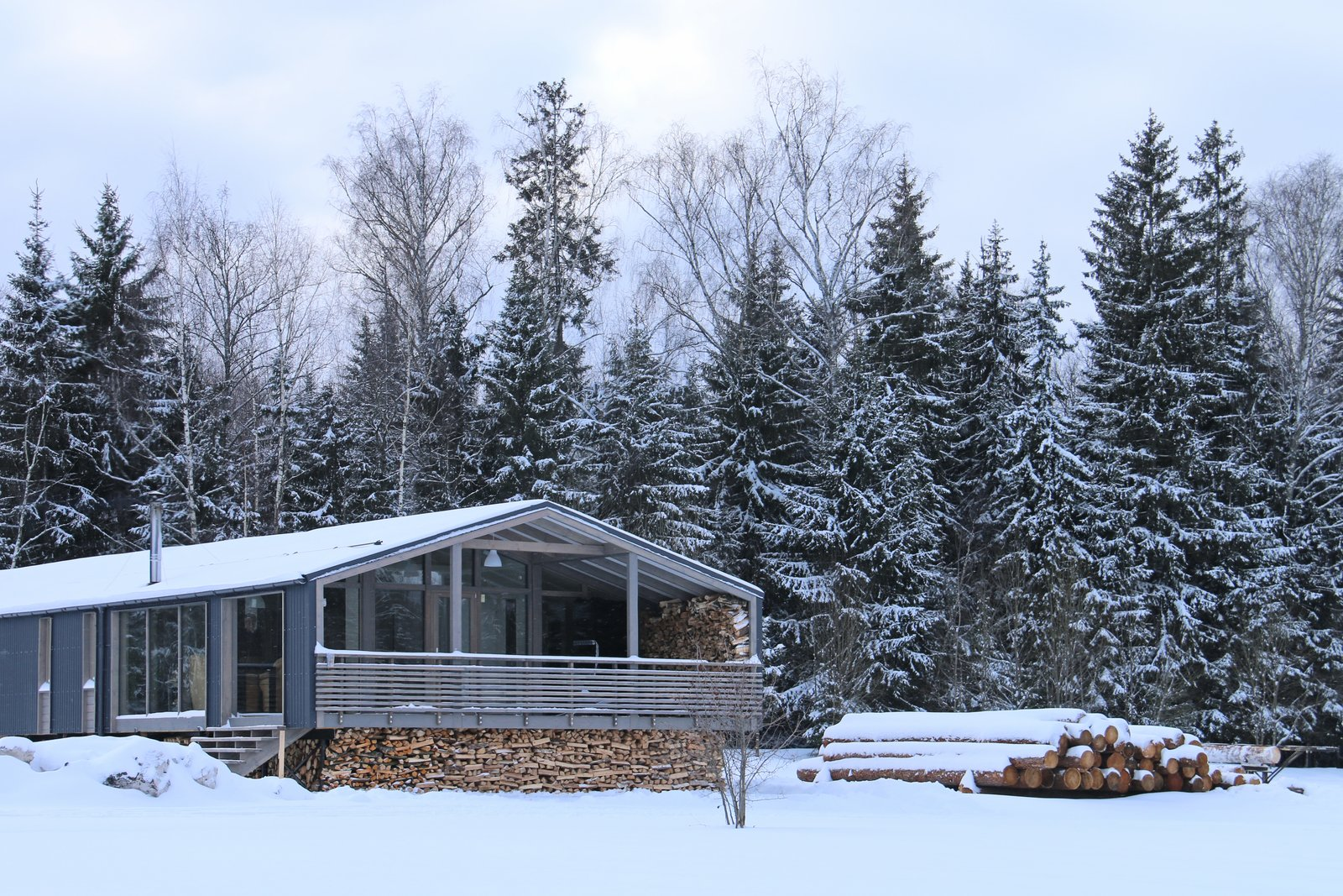 Exterior, Gable RoofLine, Cabin Building Type, and Prefab Building Type The DD 65 has approximately 700 square feet of living space.  Photo 14 of 22 in DublDom Prefab Homes Can Be Built in One Day