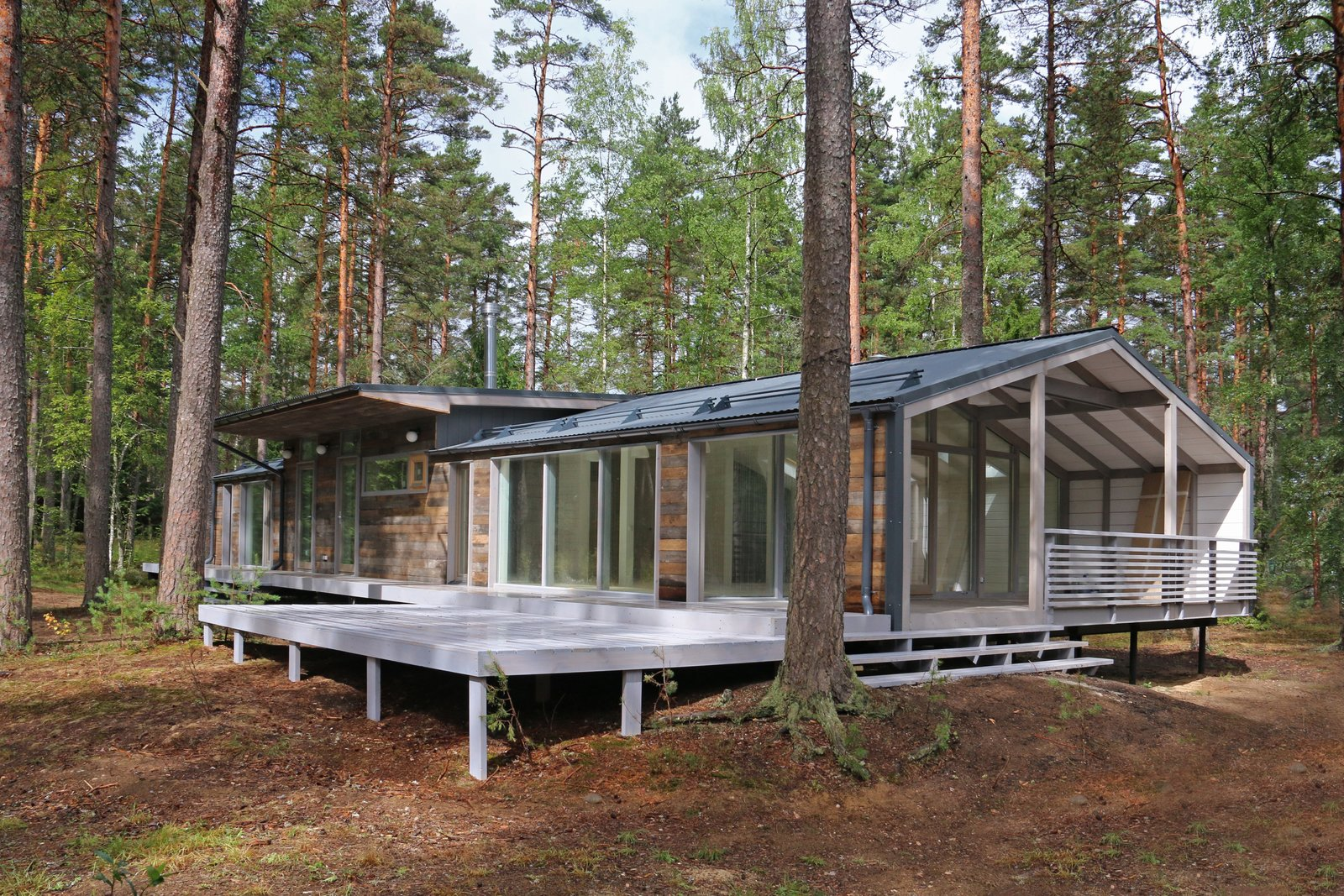 Exterior, Gable RoofLine, Cabin Building Type, and Prefab Building Type Ovchinnikov and his team can also custom design a DublDom modular prefab to your specifications, and have it ready in less than six months.  Photo 22 of 22 in DublDom Prefab Homes Can Be Built in One Day