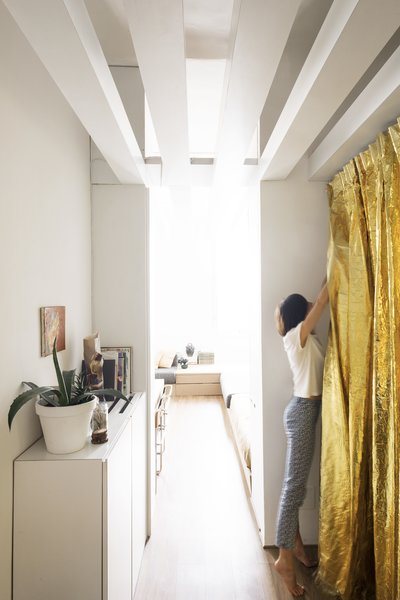 Along one side of the entrance hall is the kitchen that can be concealed with a funky, gold metallic curtain made from an isothermal emergency blanket.