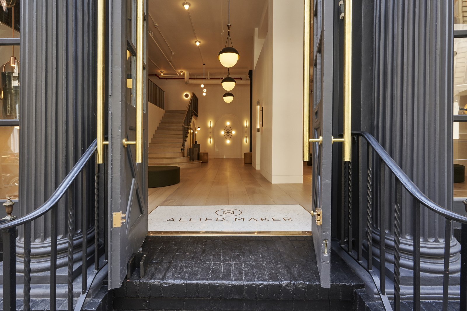 Doors, Exterior, and Swing Door Type The entrance to Allied Maker's new showroom in Tribeca, New York puts their meticulously crafted lights on immediate display.  Photo 2 of 7 in Allied Maker Turns a Dentist's Office Into a Luminous Showroom