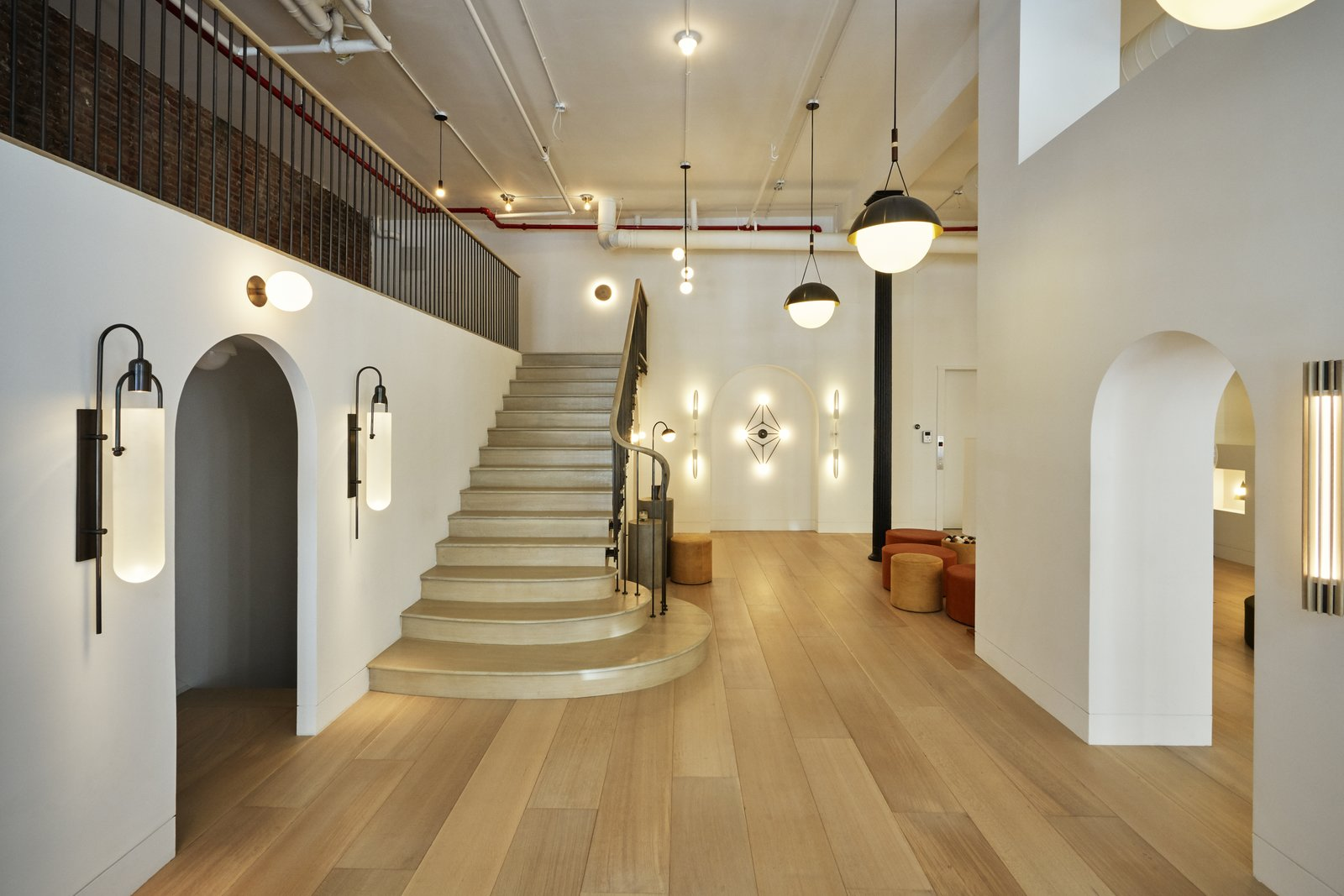"""Office, Light Hardwood Floor, and Lamps Allied Maker offers lights with six different brass finishes, which they refer to as """"honest patinas.""""  Photo 5 of 7 in Allied Maker Turns a Dentist's Office Into a Luminous Showroom"""