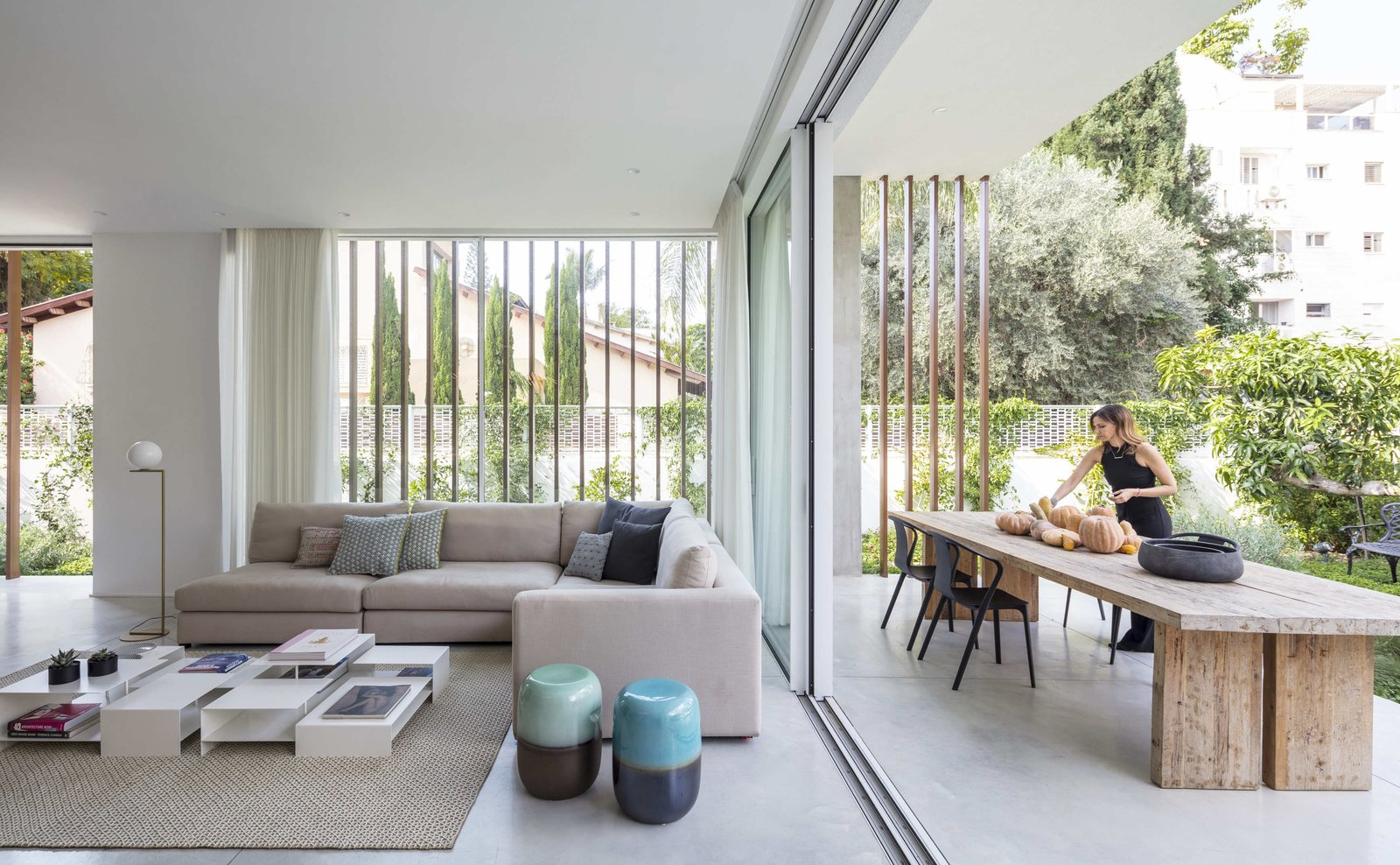Outdoor, Gardens, Back Yard, and Large Patio, Porch, Deck The roof hangs over the patio to provide shelter from the intense sunlight.  Photo 10 of 19 in Sleek Concrete Cubes Form This Pavilion-Like Home in Israel