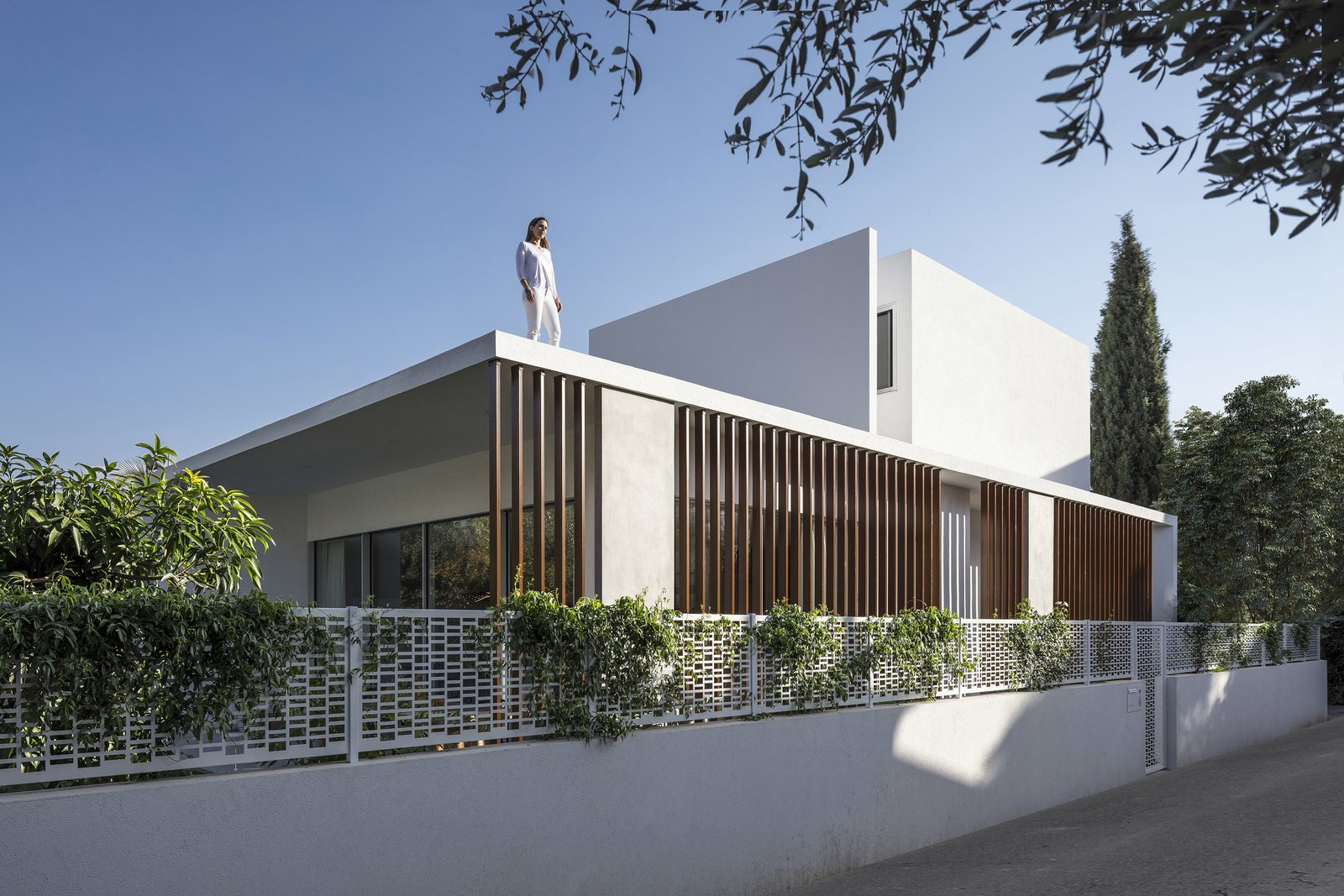 Exterior, Concrete Siding Material, Flat RoofLine, and House Building Type The fourth floor takes the form of a complete white cube with no visible windows or apertures.    Photo 4 of 19 in Sleek Concrete Cubes Form This Pavilion-Like Home in Israel