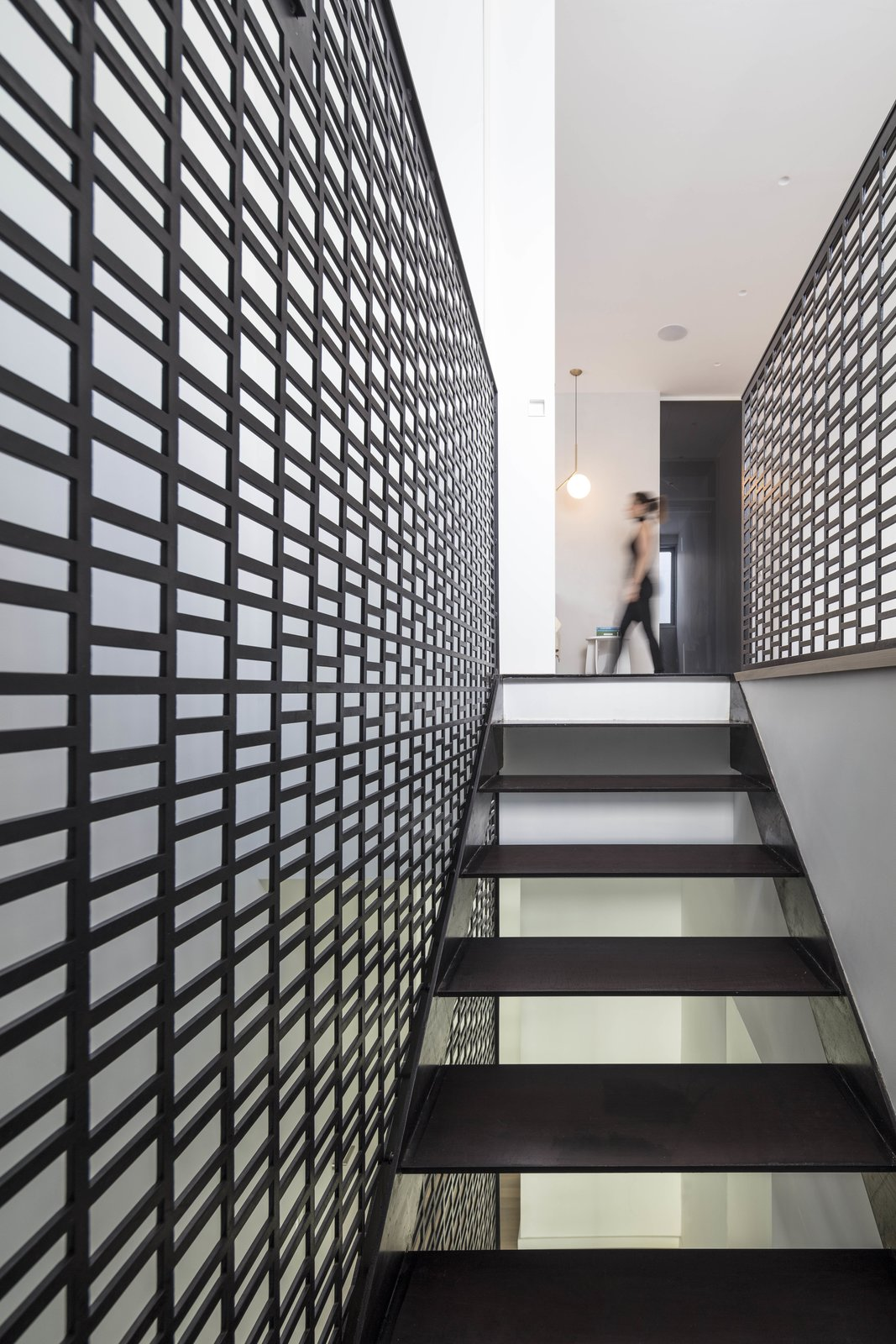 Staircase, Metal Tread, and Metal Railing Inside, the vertical lines expressed by the exterior screen are replicated in the staircase that connects the four floors.    Photo 12 of 19 in Sleek Concrete Cubes Form This Pavilion-Like Home in Israel