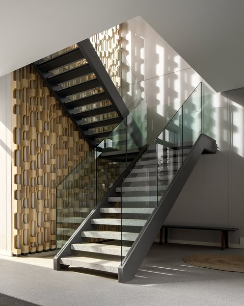A staircase leads up to private areas.