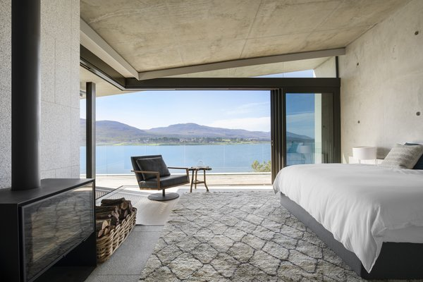 The bedrooms are located within the two upper wings. These spaces present elevated views across the lagoon to the mountains.