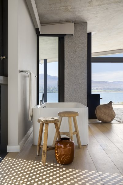 A bathroom that looks out to the lagoon.