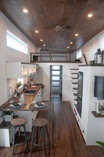 The trio, who are presently completing their tenth custom-built tiny house, approach their work with a great deal of empathy for their clients.