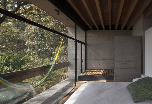 A hammock hangs on the bedroom balcony, creating an idyllic spot for relaxation.