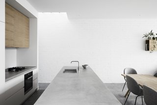 Hard materials such as polished concrete were used for the interior floors and bench-tops. The interior brick walls were all painted white.