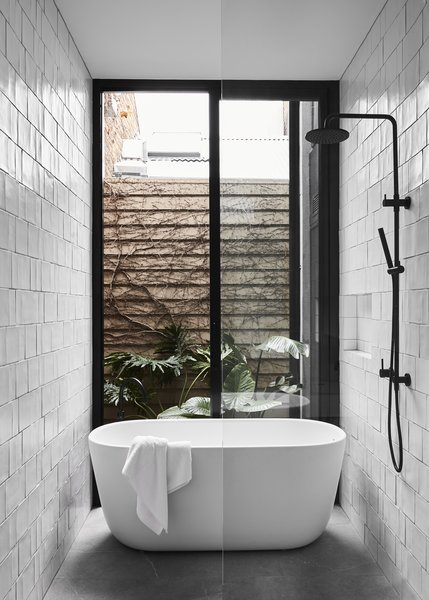 Sliding Glass Doors Next To A Freestanding Bath Provide Visual Connectivity  To The Outdoors.