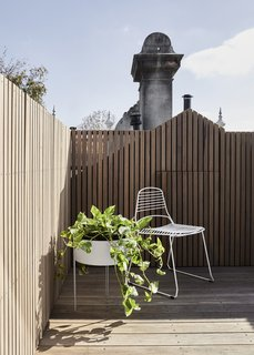 On the roof terrace is a casual chair and planter, which helps make this space a lovely spot to relax and soak up the Australian sunshine.