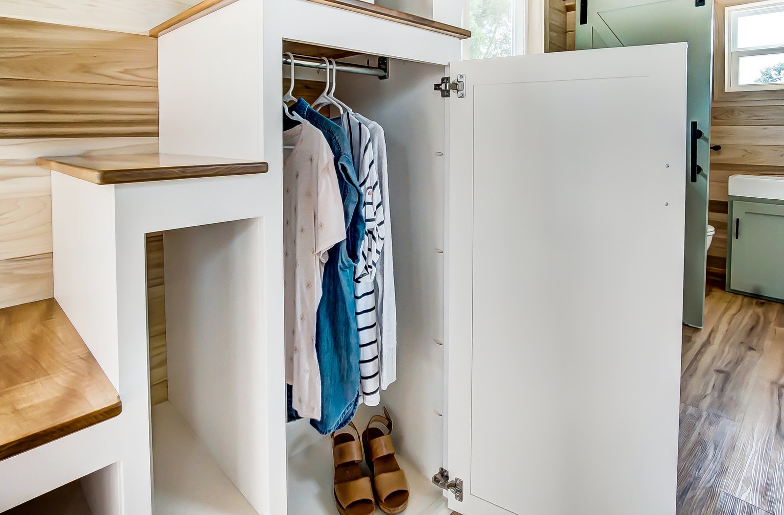 Storage Room, Closet Storage Type, and Under Stairs Storage Type Under the steps are built-in storage spaces.     Photo 9 of 11 in This 270-Square-Foot Tiny Home Is Now Up For Grabs at $89K