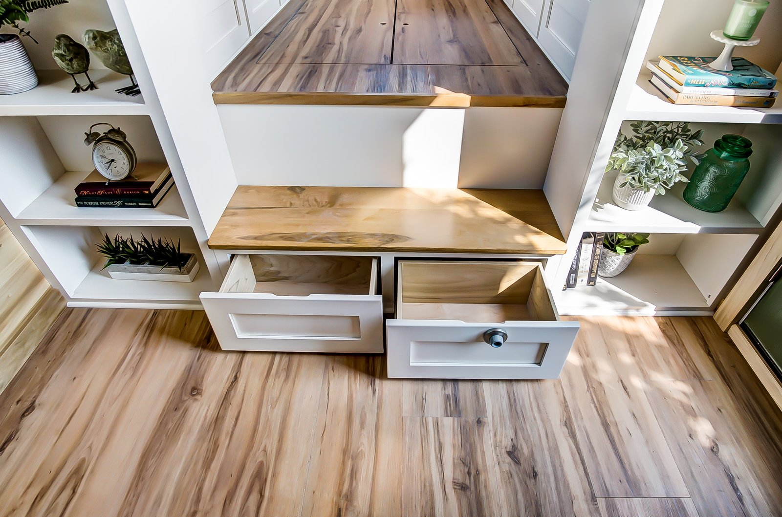 Storage Room and Under Stairs Storage Type The Clover is 24 feet long and is supported by a double-axle trailer. Featuring a steel roof, its exterior is clad in lapped smart siding.    Photo 4 of 11 in This 270-Square-Foot Tiny Home Is Now Up For Grabs at $89K