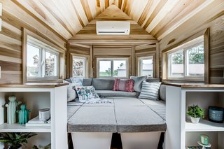 "With a spacious ""social pit"" and plenty of built-in seating, this modern tiny house is an idyllic fit for entertainers looking to downsize."