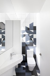 Mutina tiles have been used for the floor and walls in the kids' bathroom.
