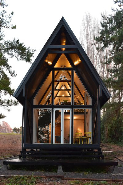 """The 1,033-square-foot Casa R opens up to a """"chiflonera,"""" an intermediate space between the interior and exterior commonly found in Patagonian homes."""