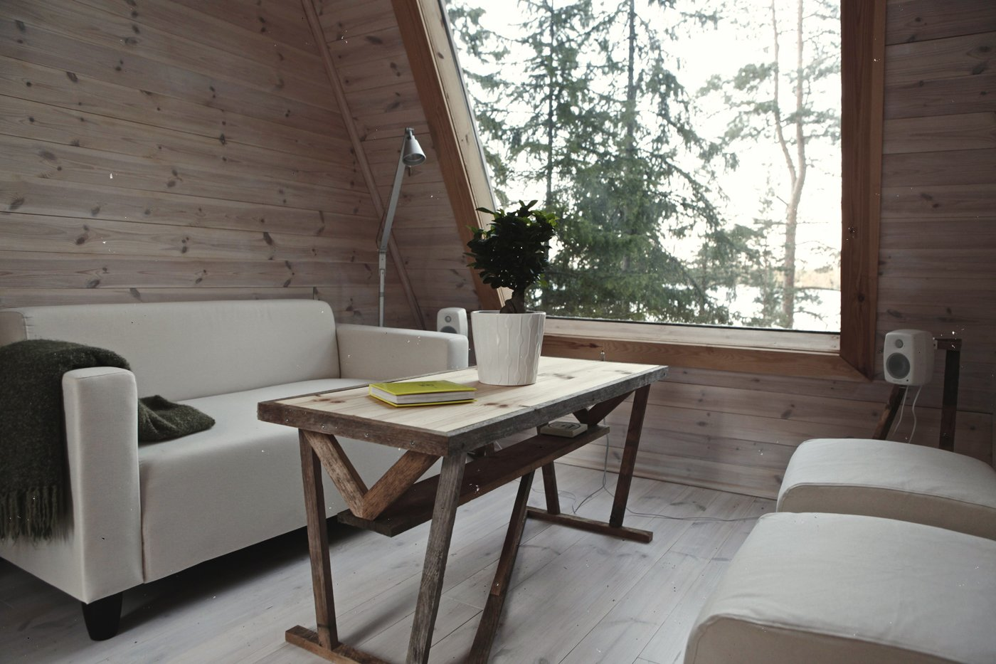 Living Room, Coffee Tables, Floor Lighting, Light Hardwood Floor, Ottomans, and Sofa Falck designed the cabin to maximize space and improve acoustics and light flow.    Photo 9 of 11 in A Tiny Cabin Is Built in Three Weeks For Only $10.5K