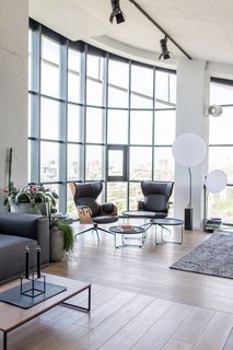 Now, common areas are concentrated around a right-angled section that follows the glazed window-walls.