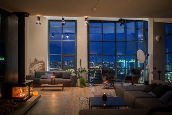 The apartment has been carefully configured to take full advantage of the 180-degree views of the city skyline.