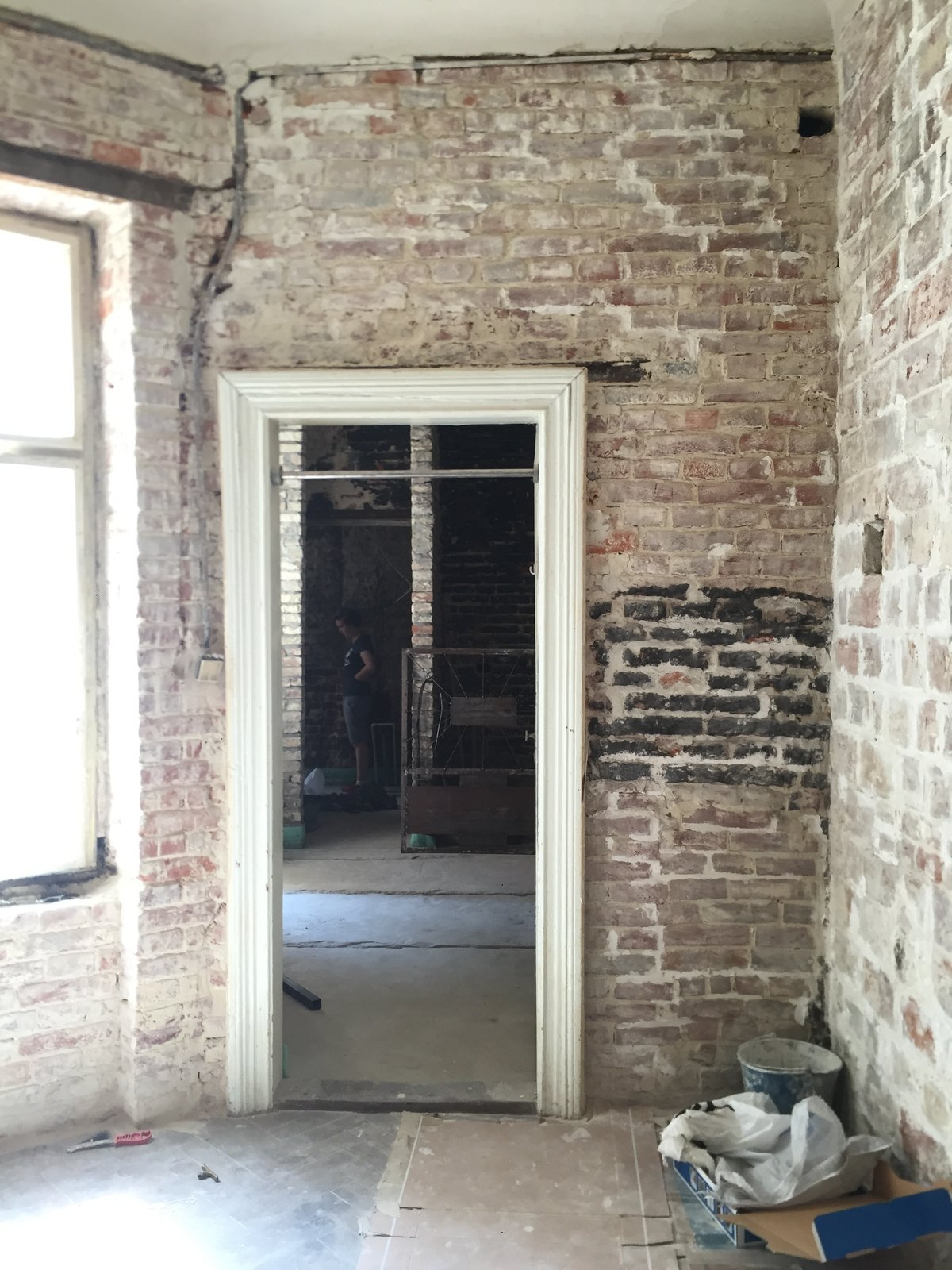 Inside, the old brick walls were kept intact and painted gray in certain sections.    Photo 3 of 16 in Before & After: A Little Flat in Ukraine Gets a Modern Upgrade
