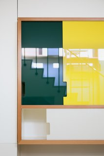 Plexiglass panels have been used for for the kitchen cabinets and staircase shelving.