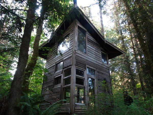 This cabin has a 100-square-foot lower level and a 70-square-foot loft. The cabin has a shed roof that rises as high as 22 feet.