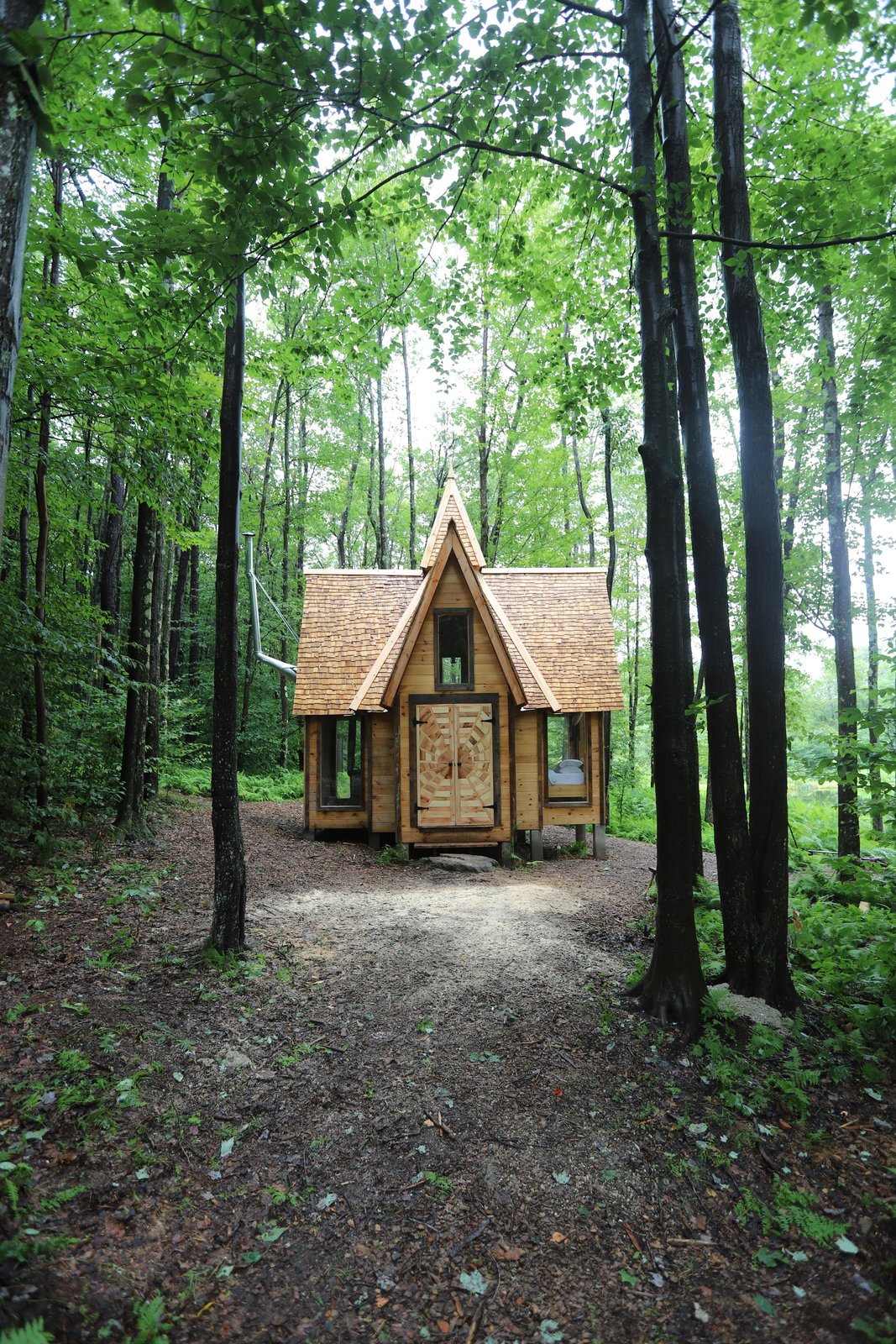 Exterior, Shingles Roof Material, Gable RoofLine, Wood Siding Material, Cabin Building Type, and Small Home Building Type The 31-foot cabin includes a four-foot spire.  Photo 18 of 21 in Jacob Witzling's Off-Grid Cabins Are Straight Out of a Fairy Tale