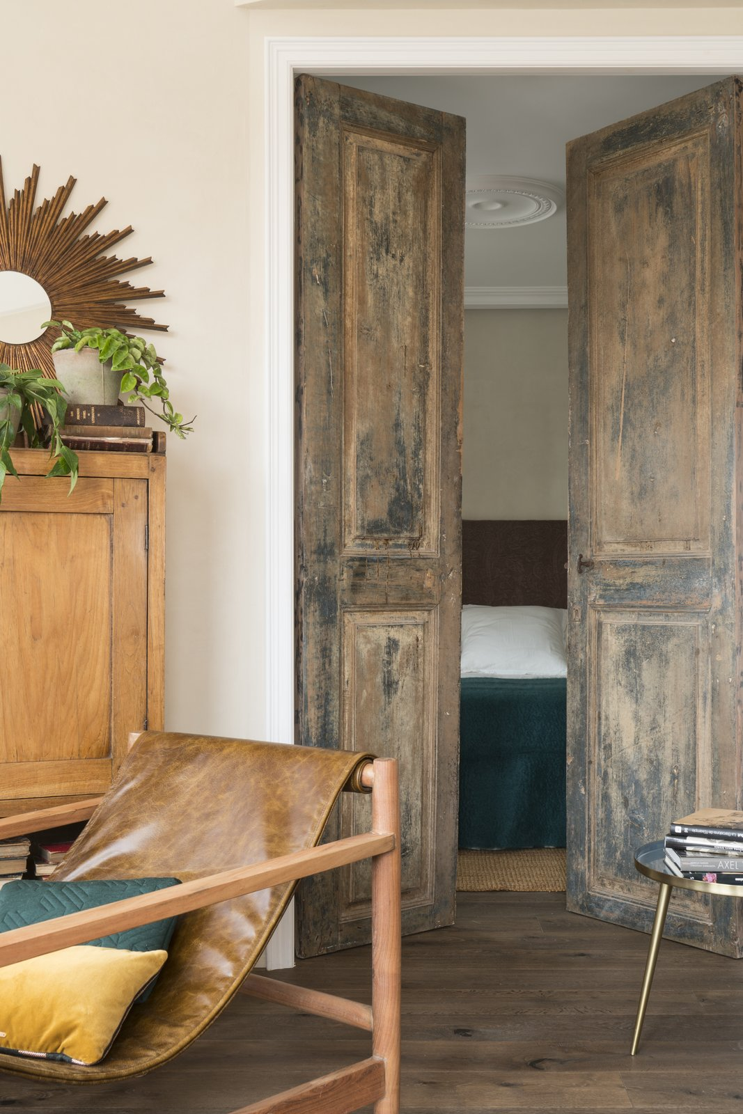 Doors, Wood, Swing, and Interior A look at the original interior door that was restored.    Best Doors Interior Swing Photos from A 1930s Barcelona Apartment Is Revitalized Into an Airy Abode