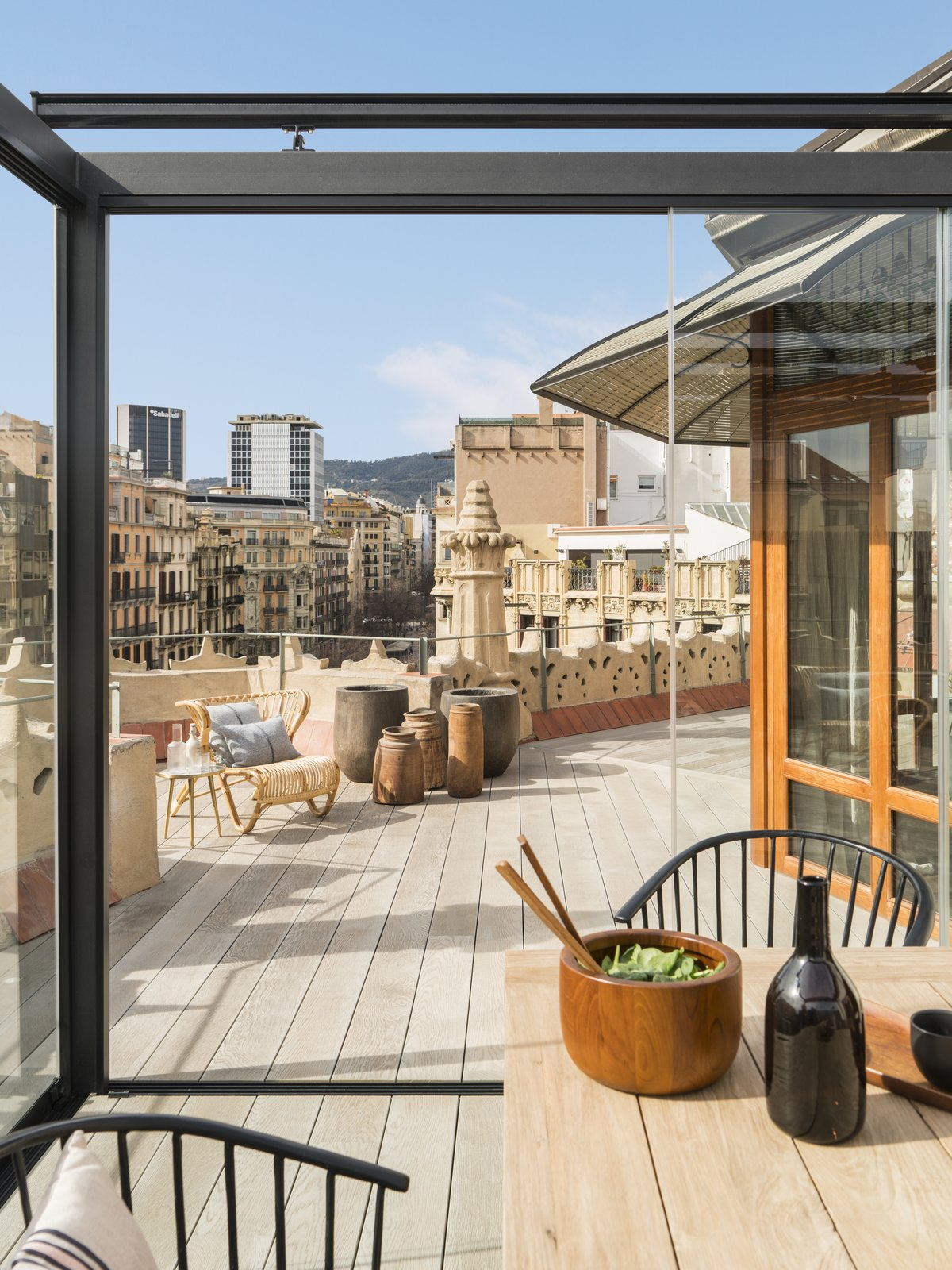 Outdoor, Large, and Rooftop Wood vases on the roof deck by Meritxell Ribé-The Room Studio.    Best Outdoor Rooftop Photos from A 1930s Barcelona Apartment Is Revitalized Into an Airy Abode