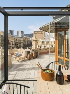 Wood vases on the roof deck by Meritxell Ribé-The Room Studio.