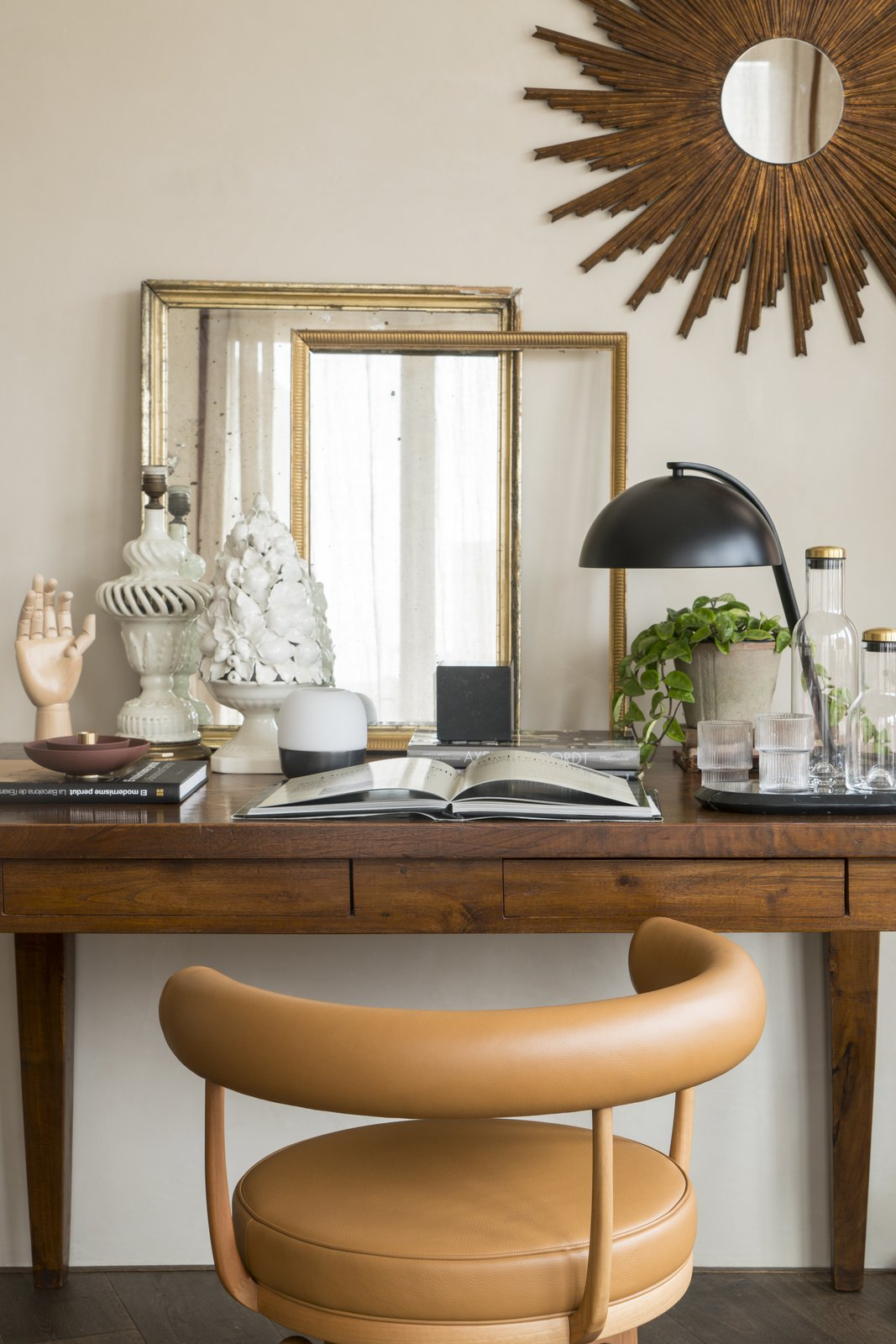 Office, Study, Chair, Dark Hardwood, and Lamps Accessories from Antique Boutique.  Office Dark Hardwood Study Lamps Photos from A 1930s Barcelona Apartment Is Revitalized Into an Airy Abode