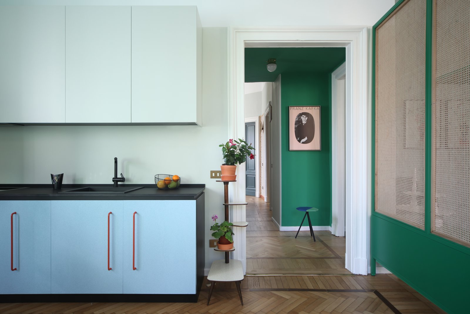 """Kitchen, Colorful Cabinet, Medium Hardwood Floor, and Drop In Sink A closer look at the kitchen.  Photos from This Delightful Abode Is a Modern Take on """"Grandma's House"""""""