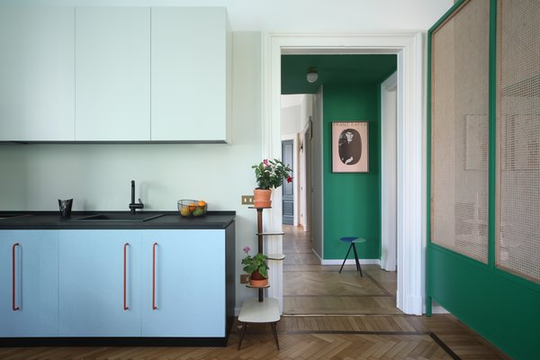 """Kitchen, Colorful Cabinet, Medium Hardwood Floor, and Drop In Sink A closer look at the kitchen.  Best Photos from This Delightful Abode Is a Modern Take on """"Grandma's House"""""""