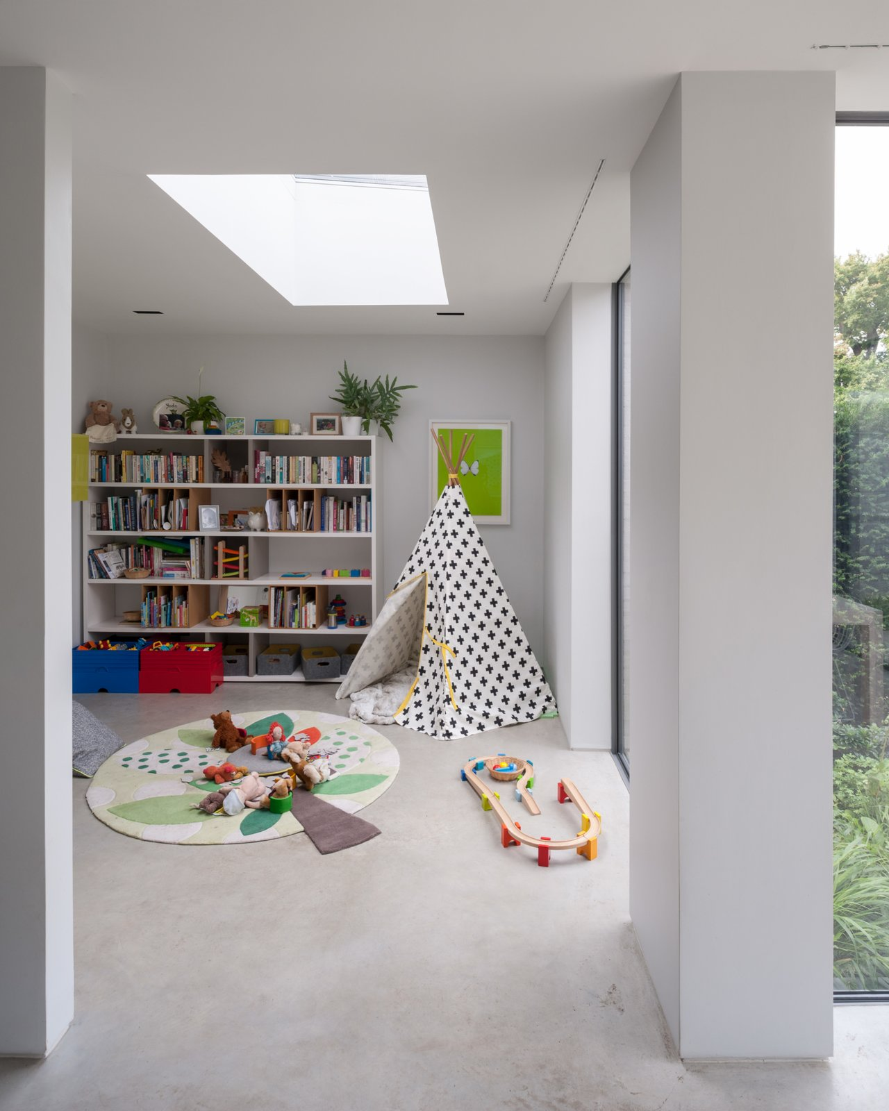 Kids Room, Playroom Room Type, Bookcase, and Toddler Age A children's playroom on the ground floor.  Photos from A Grass-Topped Addition in England Connects Home and Garden