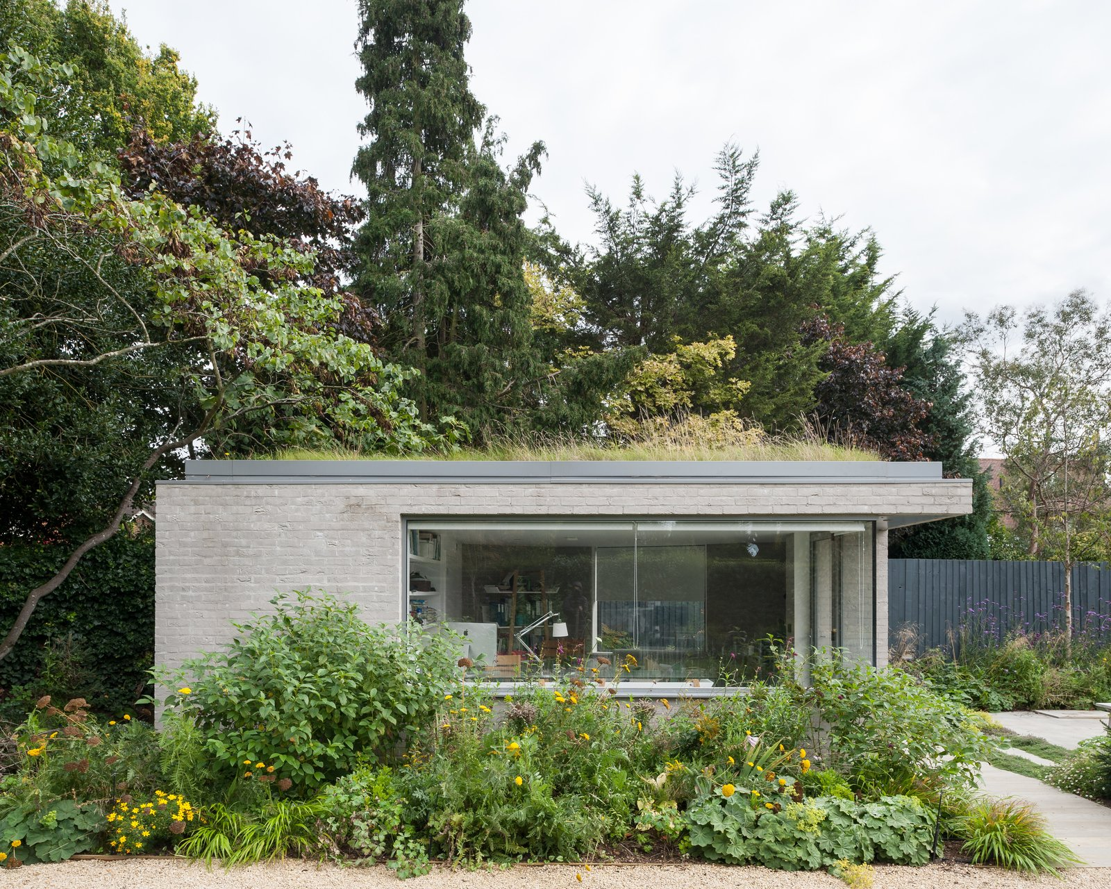 Exterior, Brick Siding Material, House Building Type, and Flat RoofLine Soup Architects built a new, stand-alone work studio in the lower section of the garden to provide a different orientation and perspective to the main house.  Best Photos from A Grass-Topped Addition in England Connects Home and Garden