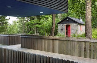 A restored cinderblock sauna sits across from the main house.