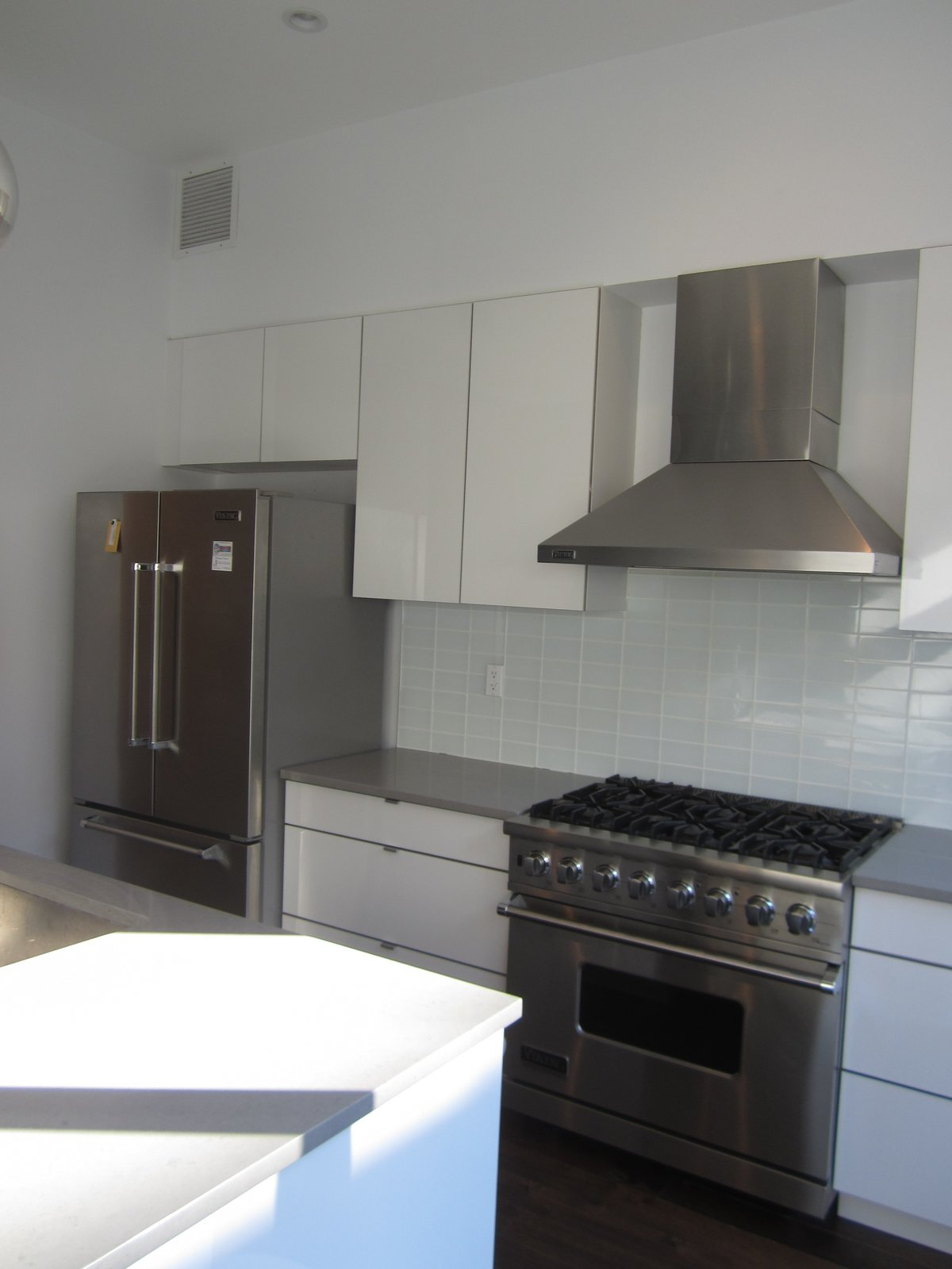 Kitchen, White Cabinet, Wall Oven, Range Hood, Cooktops, and Refrigerator Before: the original kitchen.    Photo 4 of 15 in Before & After: A Humdrum Home in Brooklyn Receives a Stylish Revamp