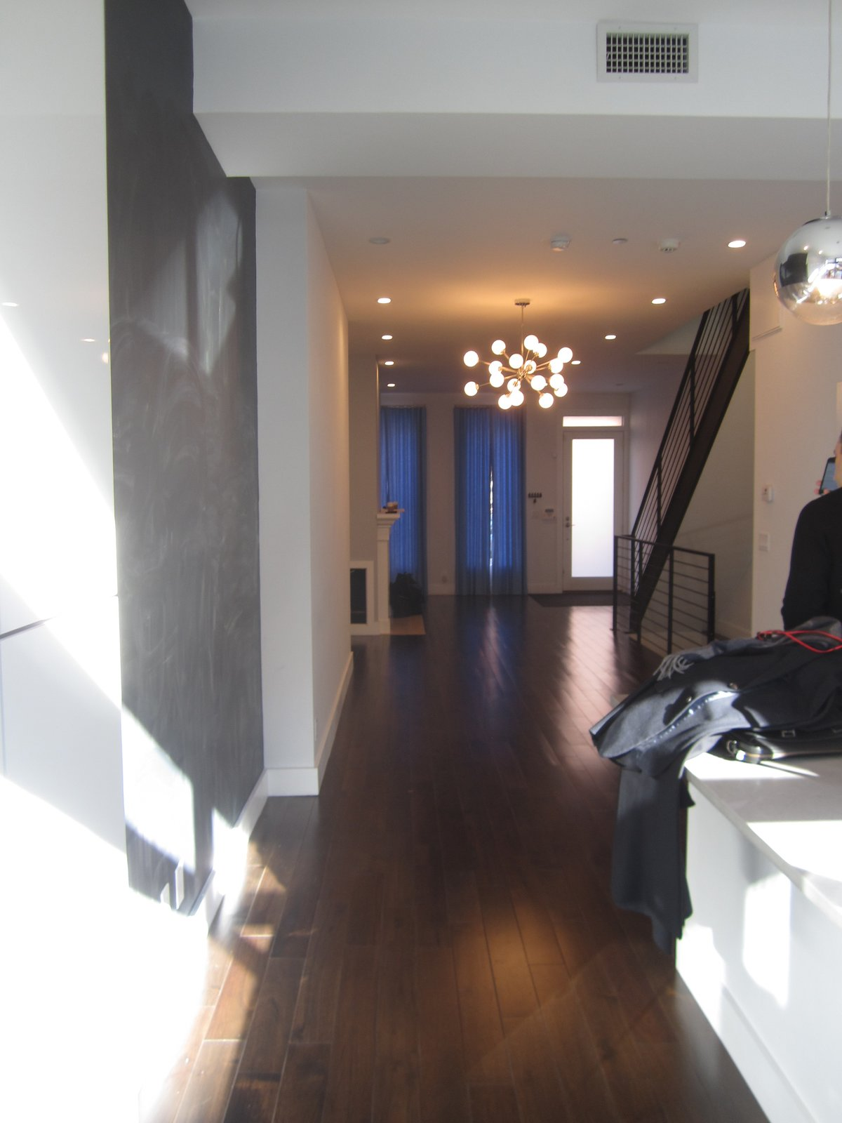 Hallway and Dark Hardwood Floor Before: the entry foyer.    Photo 2 of 15 in Before & After: A Humdrum Home in Brooklyn Receives a Stylish Revamp