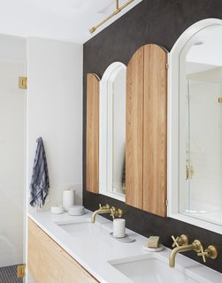 """Light fixture from Allied Maker and Bocci; custom-made white oak """"shutter"""" cabinets; plumbing fixtures by California Faucets."""