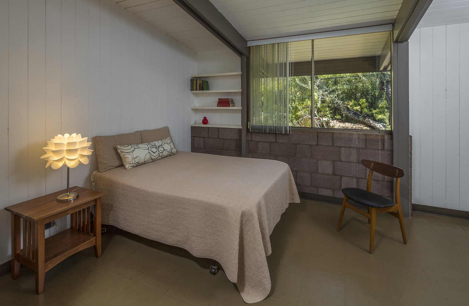 Bedroom, Lamps, Night Stands, Shelves, Bed, Chair, and Table Lighting The house has three bedrooms.  Best Photos from Own This L.A. Midcentury by A. Quincy Jones For $2.45M
