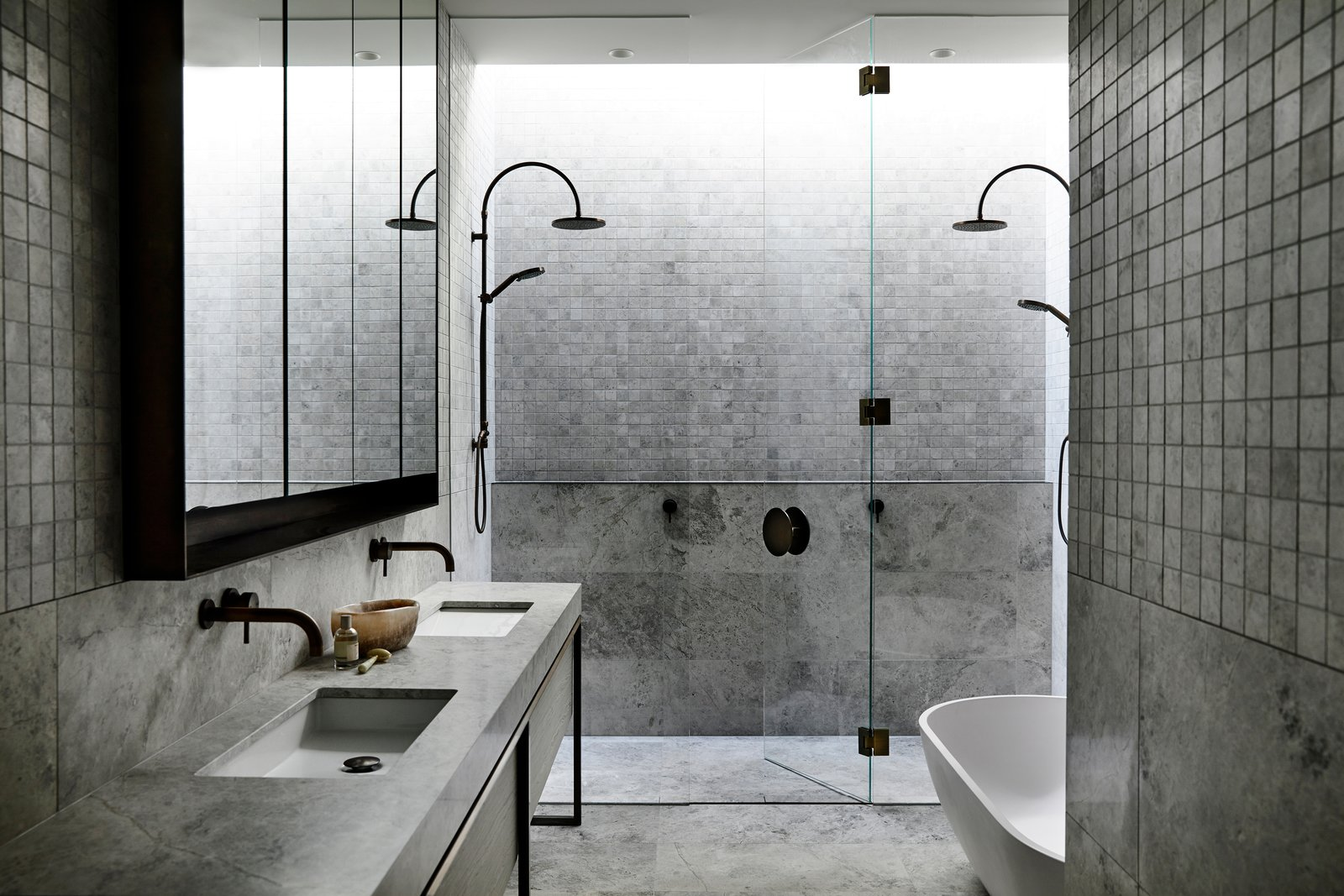 Bath Room, Enclosed Shower, Freestanding Tub, and Undermount Sink A bathroom with natural stone floor and walls.  Photos from A Strong Builder Bond Results in a Sophisticated Australian Home